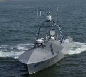 The Navy plans to use unmanned surface vessels to patrol harbors and, when armed with missiles or a .50-caliber machine gun, to protect ships